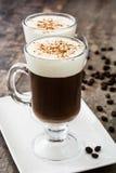 Irish coffee in glass on wood Royalty Free Stock Photos