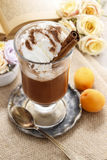 Irish coffee, open book in the background Royalty Free Stock Photo