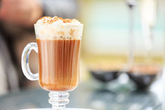 Irish coffee in an outdoor bar. Concept of St Patrick holiday. H stock image