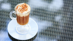 Irish coffee in an outdoor bar. Concept of St Patrick holiday. H stock photo