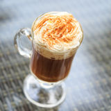 Irish coffee in an outdoor bar. Concept of St Patrick holiday. H stock images