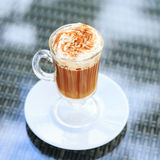Irish coffee in an outdoor bar. Concept of St Patrick holiday. H royalty free stock images