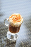 Irish coffee in an outdoor bar. Concept of St Patrick holiday. H royalty free stock image