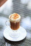 Irish coffee in an outdoor bar. Concept of St Patrick holiday. H royalty free stock photography