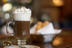 Irish Coffee. Over bar. Bokeh lights on background Stock Image