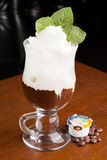 Irish Coffee in a Pub. Irish Coffee served along with coffee beans an European Pub Stock Images