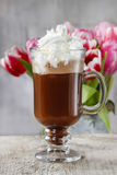 Irish coffee on wooden table Stock Image