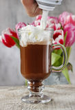 Irish coffee on wooden table Royalty Free Stock Images