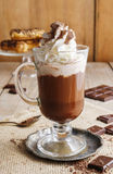 Irish coffee on wooden table Stock Images