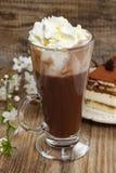Irish coffee on wooden table. Tiramisu cake Stock Image