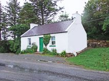 Irish cottage by the side of the road Stock Images
