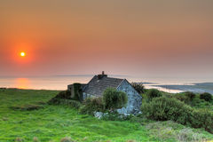 Irish cottage house at sunset Royalty Free Stock Image