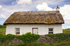Irish Cottage. A quaint Irish cottage with a traditional thatched roof Royalty Free Stock Photos