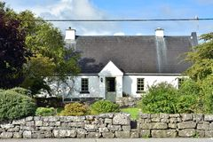 Irish country cottage with high roof Stock Photo