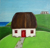 Irish Country House. An irish traditional country house with thatch,  in the midst of meadows Royalty Free Stock Image