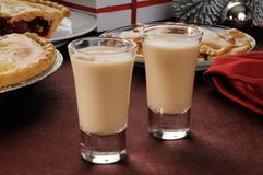 Irish cream shooters. Two Irish cream shooters in shot glasses with Christmas candies and pies Stock Images