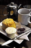 Irish cream tea. Scones, cream, jam and tea Royalty Free Stock Image