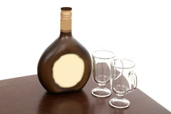 Irish Creme Bottle and Two Empty Glasses Royalty Free Stock Images