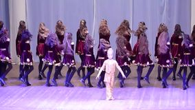 Irish dance. DNIPROPETROVSK, UKRAINE - FEBRUARY 14, 2016: Unidentified girls, ages 9-14 years old, perform Irish dance at the concert hall stock video