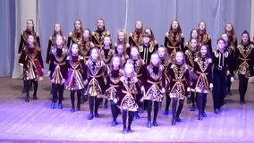 Irish dance. DNIPROPETROVSK, UKRAINE - FEBRUARY 14, 2016: Unidentified girls, ages 9-14 years old, perform Irish dance at the concert hall stock video footage