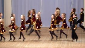 Irish dance. DNIPROPETROVSK, UKRAINE - FEBRUARY 14, 2016: Unidentified girls, ages 9-14 years old, perform Irish dance at the concert hall stock footage