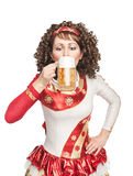 Irish dancer drinking beer Stock Photography