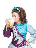Irish dancer drinking beer Royalty Free Stock Photography