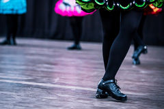 Irish Dancer Legs. Legs and feet of a female Irish dancer using the traditional Irish dancing hardshoes on parquet stock photography