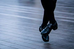 Irish Dancer Legs. Legs and feet of a female Irish dancer using the traditional Irish dancing hardshoes on parquet royalty free stock photo