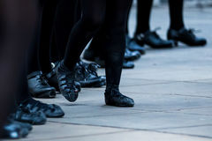 Irish Dancer Legs. Legs and feet of a female Irish dancer using the traditional Irish dancing hardshoes and softshoes on parquet royalty free stock photography