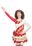 Irish dancer raise hand up isolated. Young woman in irish dance dress and wig raise hand up isolated Royalty Free Stock Photography