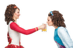 Irish dancers drinking beer Stock Photo