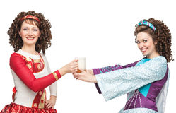 Irish dancers with mug of beer Stock Photography