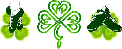 Irish dancing shoes on green clovers Stock Photo