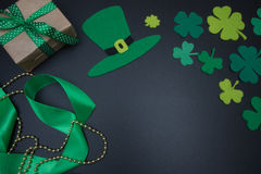 Irish decorations for St. Patricks Day clover leaves on blackboard Stock Photography