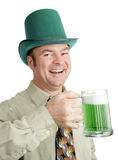 Irish Drinking Song. Man of Irish heritage enjoying a green beer on St. Patrick's Day and singing a drinking song.  Isolated on white Royalty Free Stock Photo