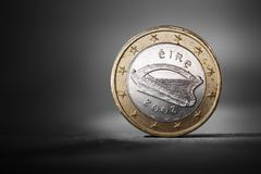 Irish Euro. Irish one euro coin showing the national backside. Short depth-of-field Royalty Free Stock Photos
