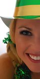 Irish Eye. Half Face shot of a Beautiful Irish Lass in a St. Patty's Day Party Hat Royalty Free Stock Photo