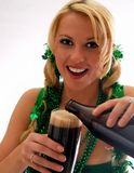 Irish Eyes!. Beautiful Irish Lass Pouring a Pint Stock Photo