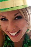 Irish Eyes!. Half Face shot of a Beautiful Irish Lass in a St. Patty's Day Party Hat Royalty Free Stock Images