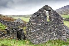 Irish Farmhouse Ruin on Mountain. Ruins of an old farm abandoned during the Irish Famine on Slea Head Drive, Dingle Peninsula, Ireland Stock Image