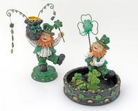 Irish Figures. Leprechaun candle stick holder and Leprechaun candy dish with kiss me frog. Isolated Royalty Free Stock Photo