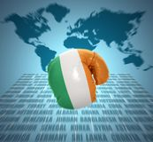Irish Fist. Boxing glove with the flag of Ireland in motion on world map background stock image