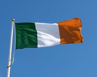 Irish flag. On blue sky royalty free stock photos