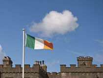Irish Flag. In the wind above historic building Stock Image