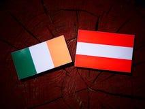 Irish flag with Austrian flag on a tree stump  Stock Images