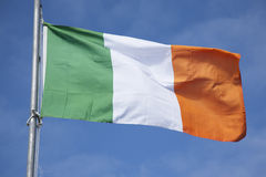 Irish Flag. On Blue Sky Background stock photo