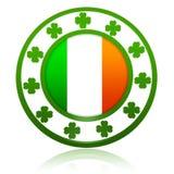 Irish flag in circle with shamrocks. Irish flag in 3d circle badge with green shamrocks Royalty Free Stock Images