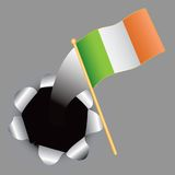Irish flag coming out of hole Stock Image