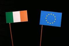 Irish flag with European Union EU flag  on black. Background Royalty Free Stock Images